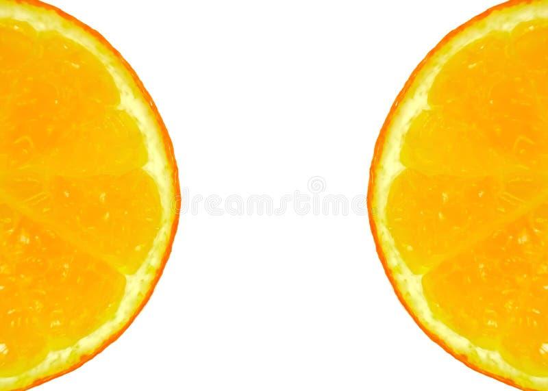 Duas meias laranjas cortadas fotografia de stock royalty free