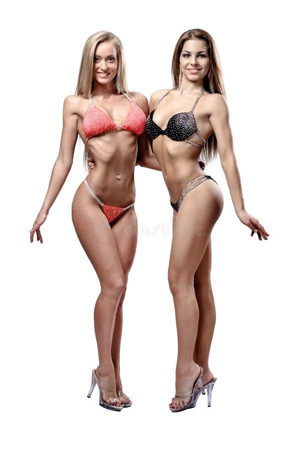 Duas meninas atléticas bonitas fotografia de stock