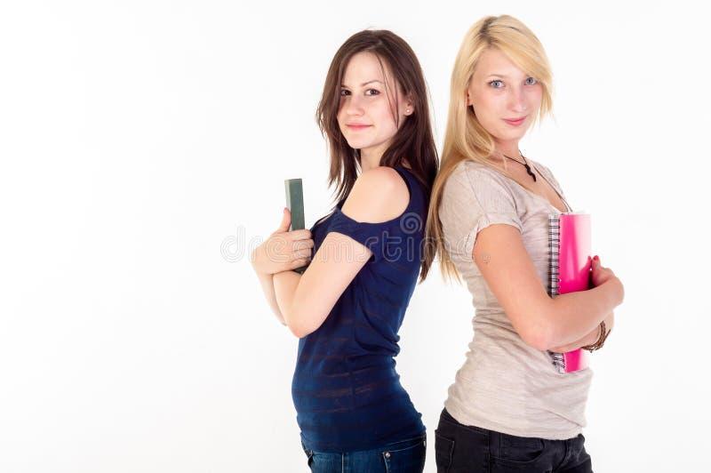 Download Duas Meninas Bonitas Do Estudante Imagem de Stock - Imagem de livro, aprenda: 26512809