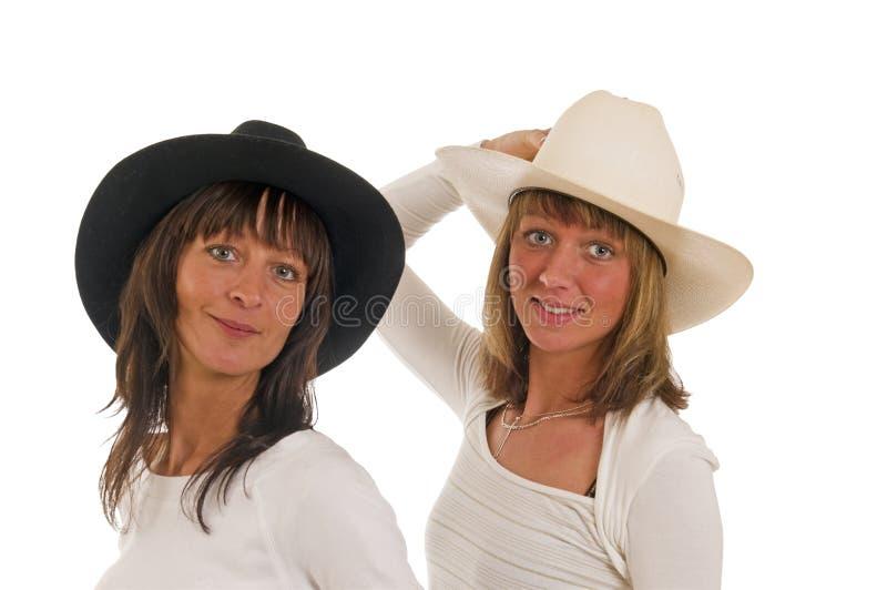 Duas meninas com chapéu de cowboy fotos de stock royalty free
