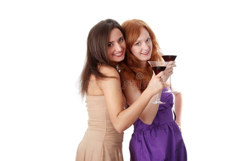 Duas meninas de partido com bebidas imagem de stock royalty free