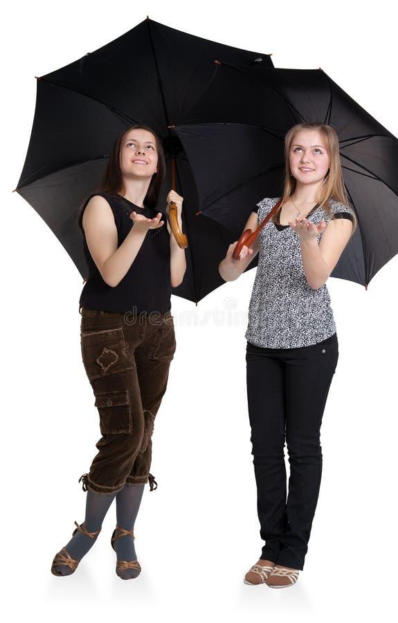 Duas meninas estão escondendo de foto de stock royalty free
