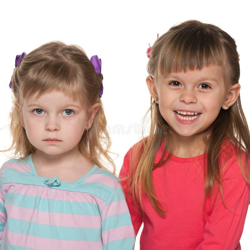 Duas meninas estão estando junto fotografia de stock royalty free