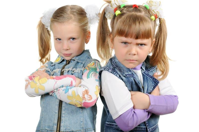Duas meninas irritadas fotografia de stock royalty free