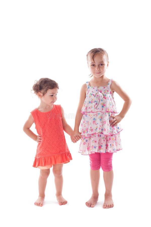 Duas meninas isoladas imagens de stock royalty free