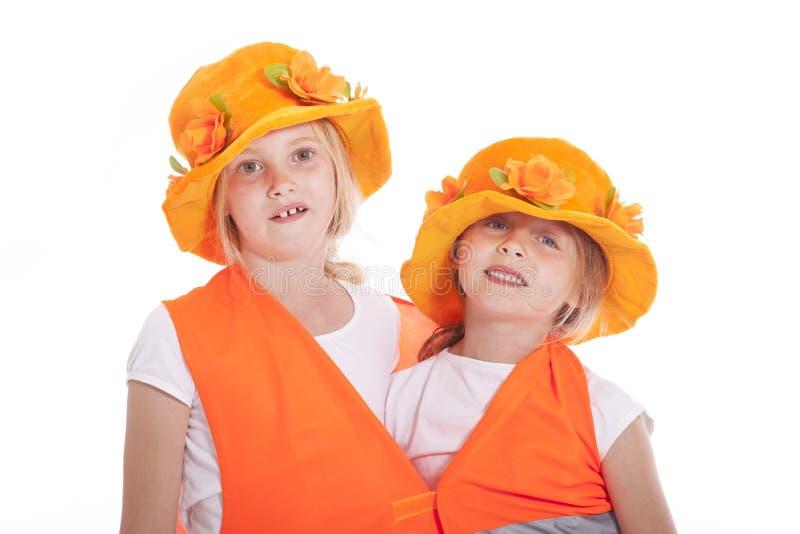 Duas meninas no equipamento alaranjado fotos de stock royalty free