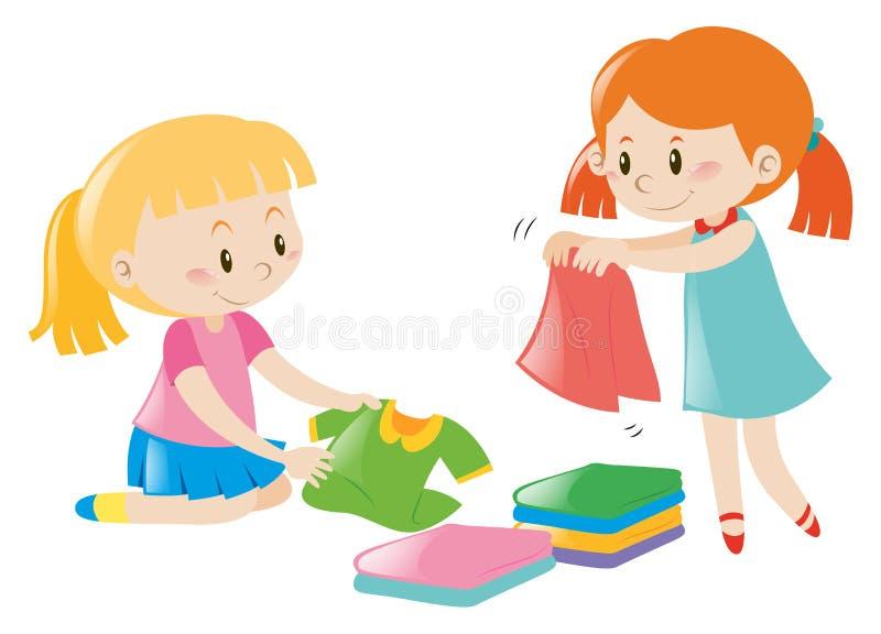 Duas meninas que dobram a roupa ilustração royalty free