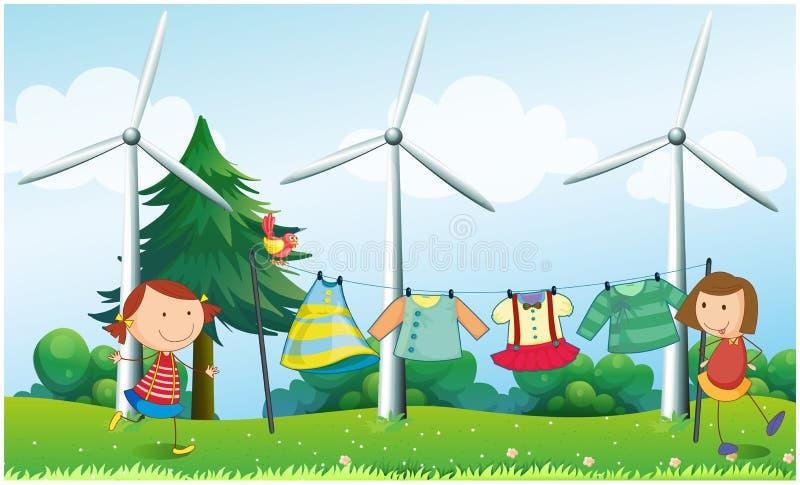 Duas meninas que penduram sua roupa perto dos moinhos de vento ilustração do vetor