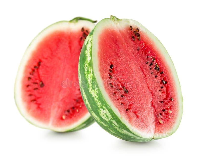 Duas metades da melancia isoladas em um fundo branco imagem de stock royalty free