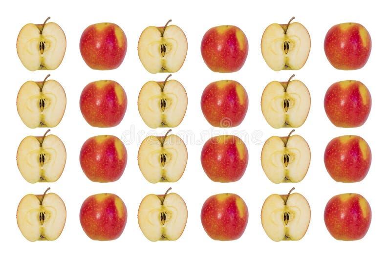 Duas metades de Apple vermelho em um fundo branco imagens de stock