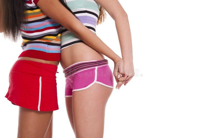 Duas mulheres da lésbica no short fotos de stock royalty free