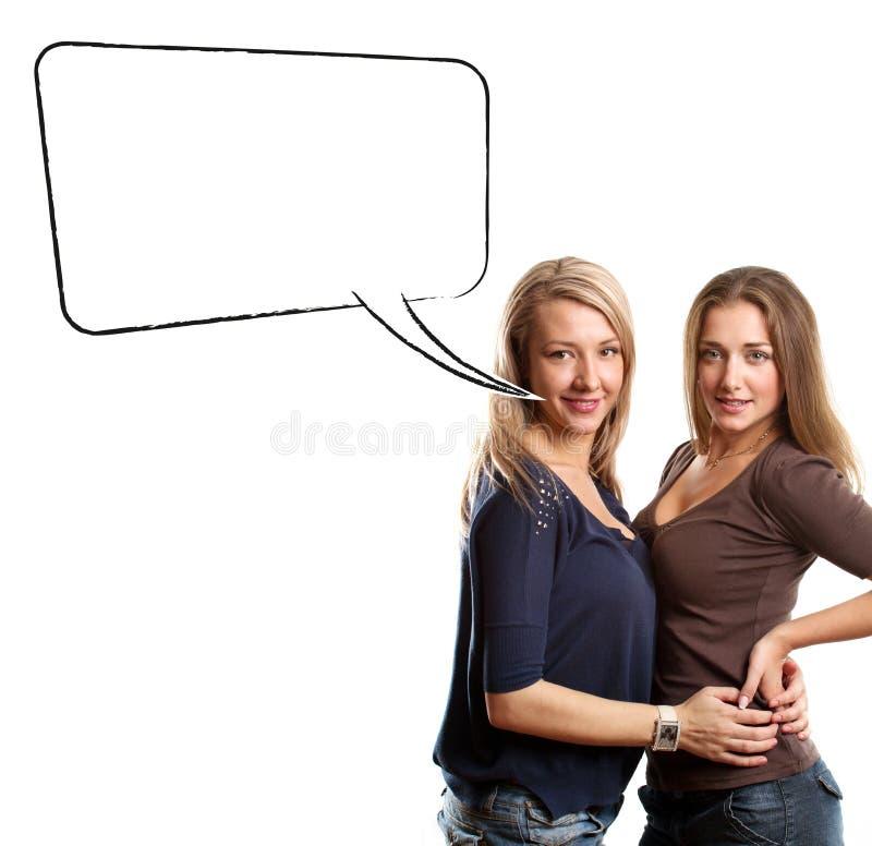 Duas mulheres europeias com bolha do discurso fotografia de stock