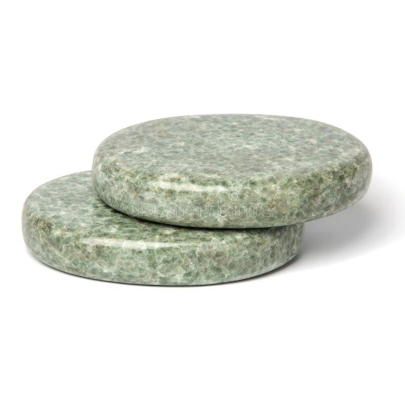 Duas pedras lustradas esverdeados da jadeíte para a massagem dos termas imagem de stock