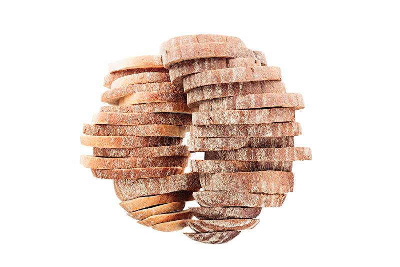 Duas pilhas de pão cortado sob a forma das esferas em um fundo branco Isolado imagens de stock
