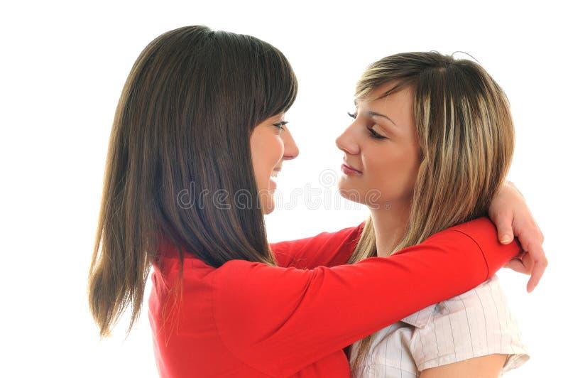 Duas raparigas isoladas no branco fotos de stock