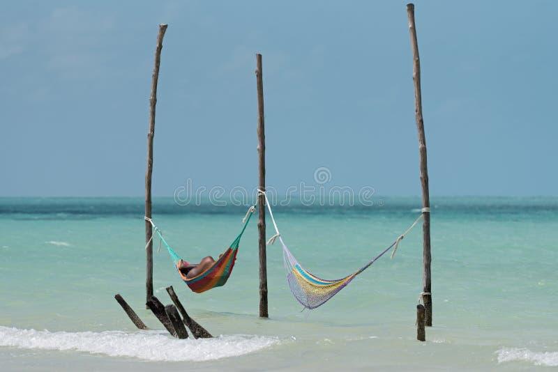 Duas redes na praia de Holbox, México imagens de stock royalty free