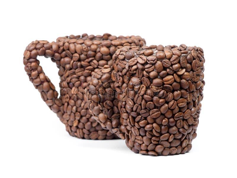 Duas xícaras de café feitas dos feijões de café imagem de stock royalty free