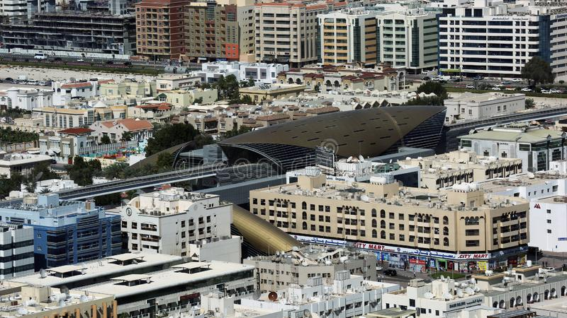 Dubai from birds eye view, United Arab Emirates, UAE. Birds eye view at part of Dubai with futuristic building of metro station. United Arab Emirates, UAE stock photo