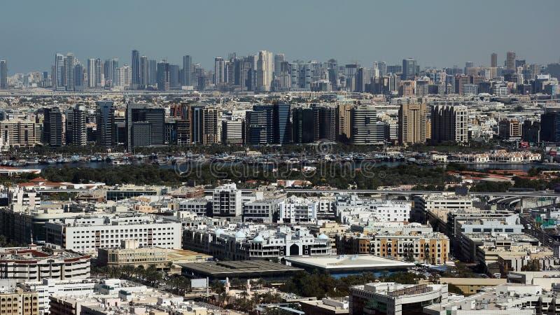 Dubai from birds eye view, United Arab Emirates, UAE. Birds eye view at part of Dubai with skyscraper buildings. United Arab Emirates, UAE stock image
