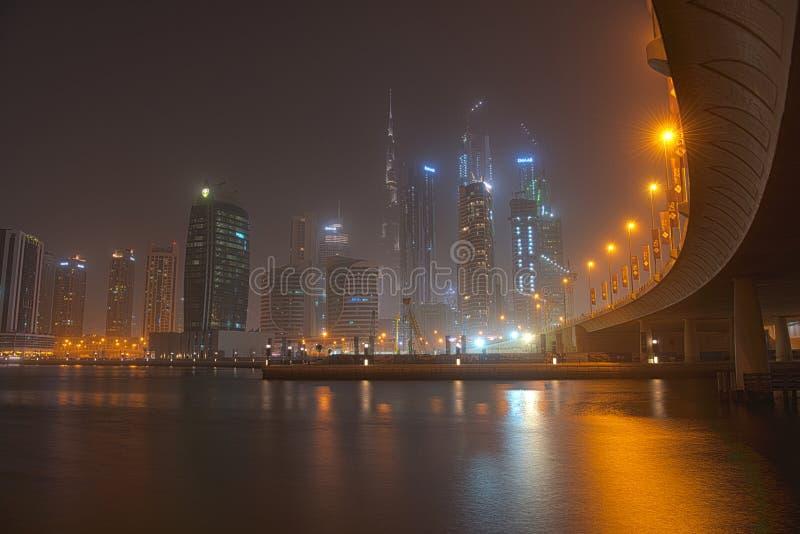 Dubai Burj Khalifa nachts, Ansicht von Dubai Creek lizenzfreies stockfoto