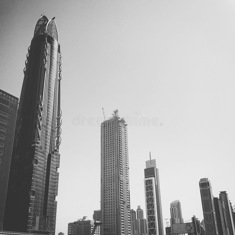 Dubai central UAE sky scrapers. Dubai UAE sky scrapers cityscape Black and white image royalty free stock photography