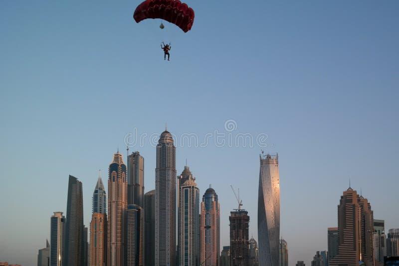 Dubai city fun parachuting and water activities, Tourist attractions at Dubai Marina.  royalty free stock photography