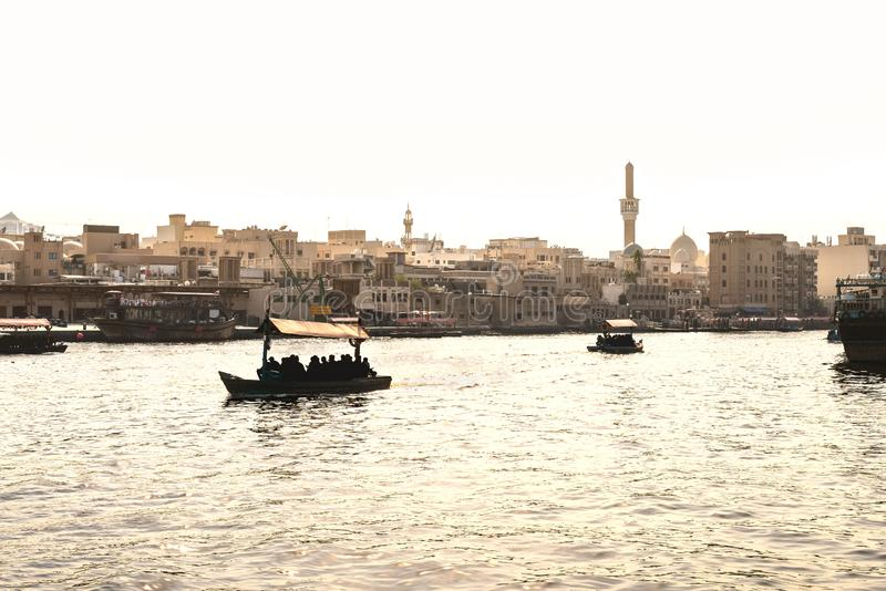 Dubai Creek with abra boats. Local people and tourists using water taxi and ferry in old town river. Traditional cruise. royalty free stock images