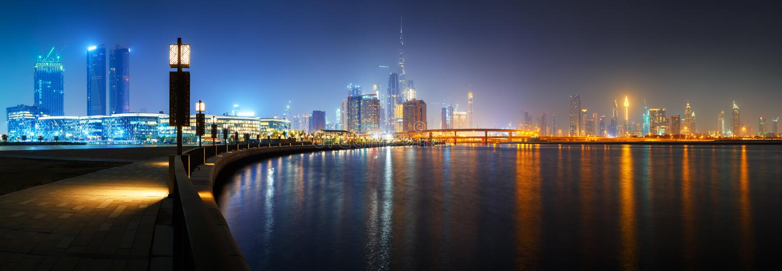 Dubai downtown city center skyline. Beautiful HD panoramic view to Dubai downtown city center skyline from Design District promenade at night, United Arab stock photos