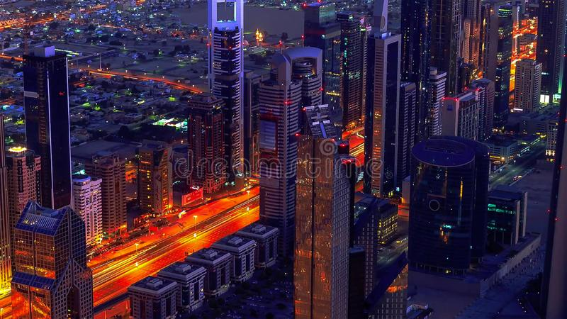 Dubai downtown night to day transition timelapse with modern skyscrapers, mall and traffic on the road before sunrise. Top view stock photos