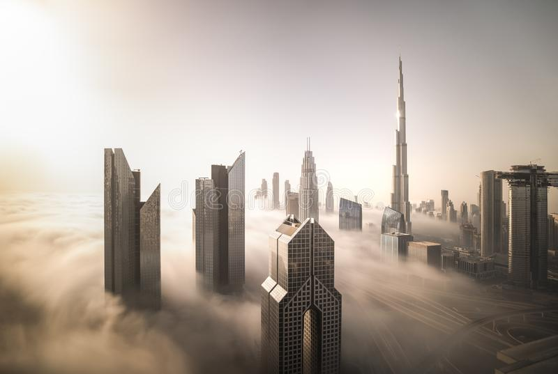 Dubai Downtown on a foggy morning. stock photos