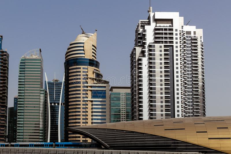 Dubai downtown skyscrapers, highway and metro. royalty free stock photography