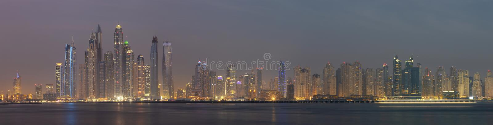 Dubai - The evening panorama of Marina towers from Palm Island stock images
