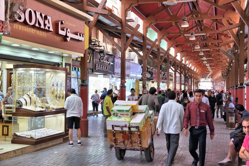 Dubai Gold Souk. DUBAI, UAE - DECEMBER 10, 2017: People visit the Gold Souk in Dubai, UAE. The Gold Market has 300 retailers and is located in Al Dhagaya part of stock photo