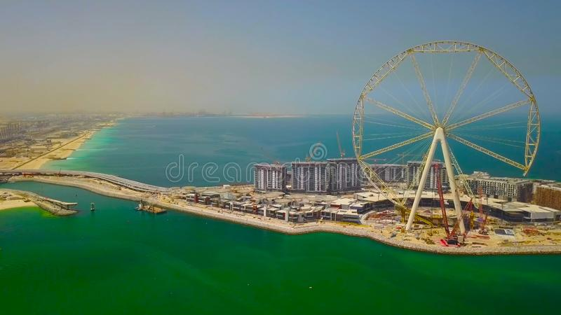 Dubai Marina beach. UAE. || ferris wheel in the park by the lake 2018 stock images