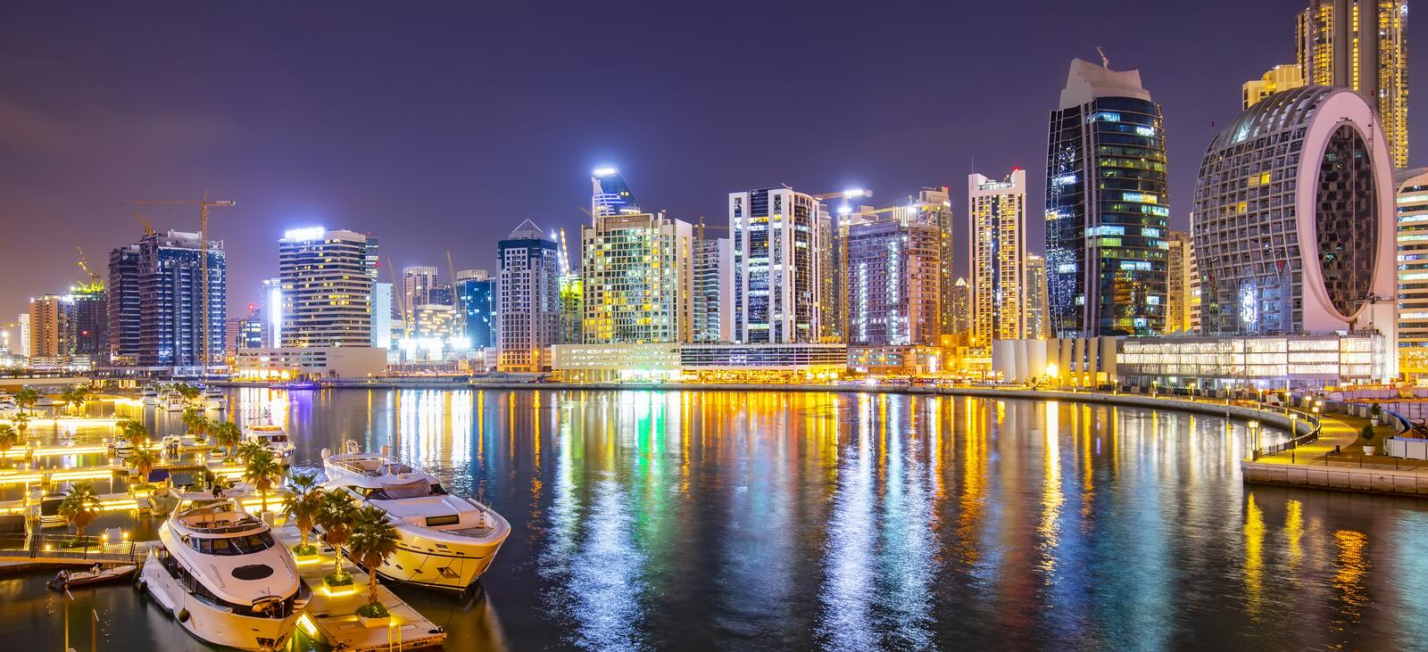 Dubai marina district at night, UAE royalty free stock photography