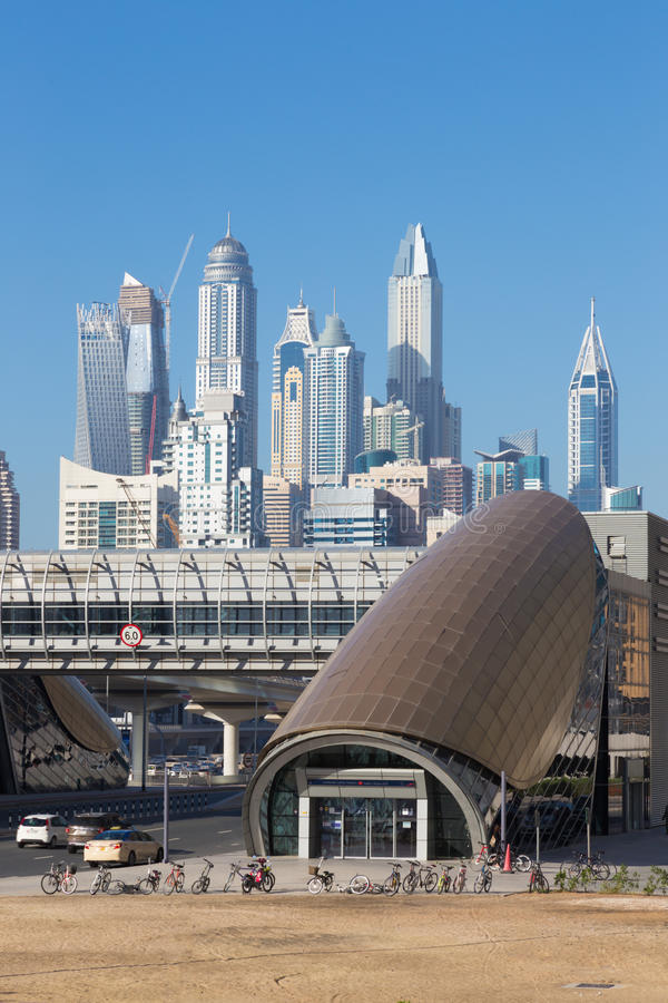 Dubai - The Marina towers and the rails of metro stock photography