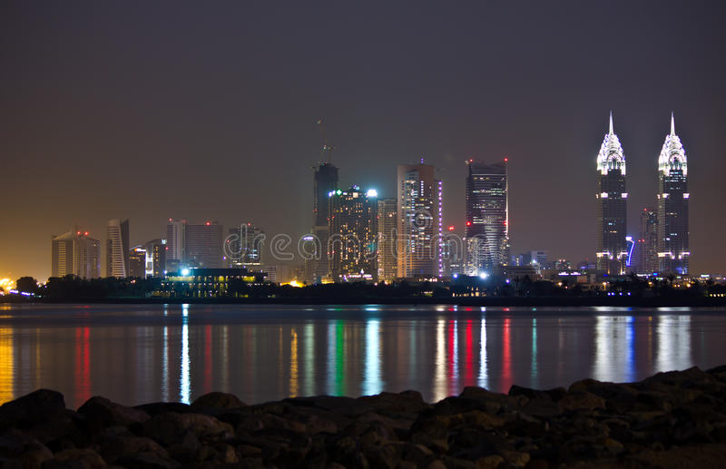 Download Dubai at night stock photo. Image of water, reflection - 25719656