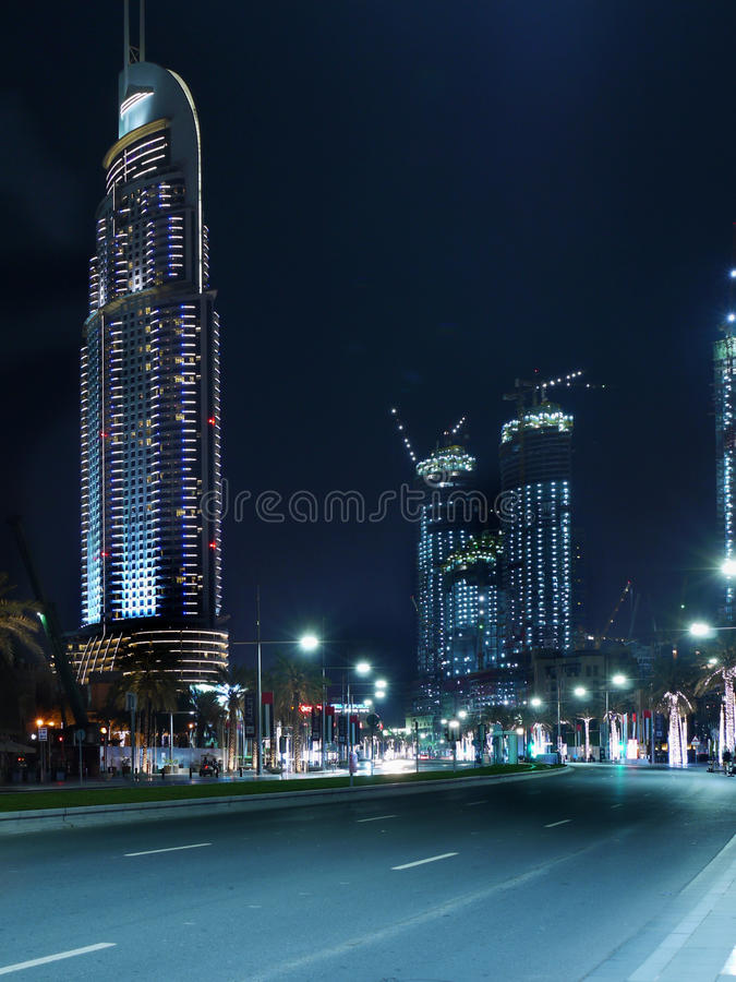 Dubai, Night view. Dubai at night, street view. The Address Downtown Hotel ( before fire). UAE royalty free stock photography