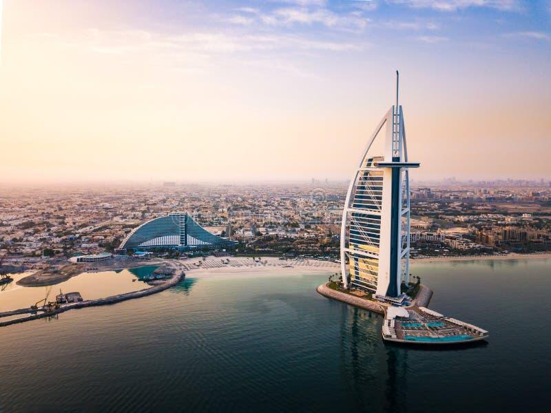 Dubai seaside skyline and Burj Al Arab luxury hotel at sunrise. Dubai seaside skyline and Burj Al Arab luxury hotel aerial view at sunrise, jumeirah, above stock photos