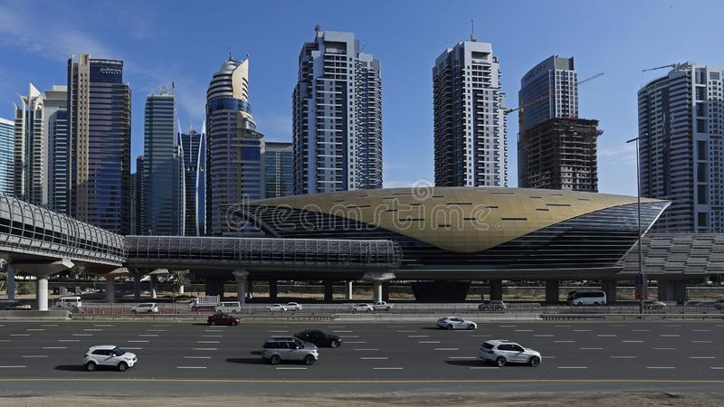 Dubai skyline and metro station, United Arab Emirates, UAE. Skyline view with futuristic building of metro station and daily traffic on Dubai roads. United Arab royalty free stock image