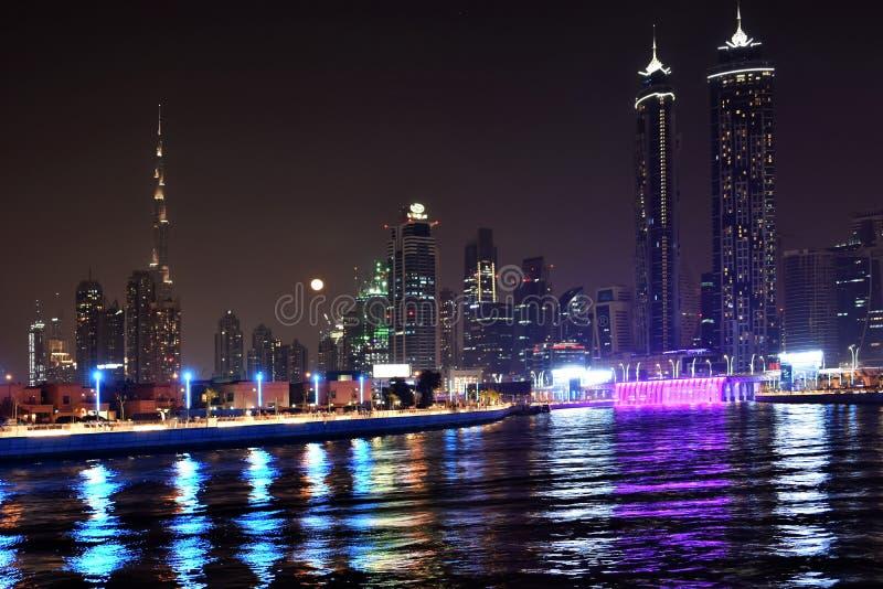 Dubai Skyline at night from new Dubai Canal, U.A.E.  stock photo