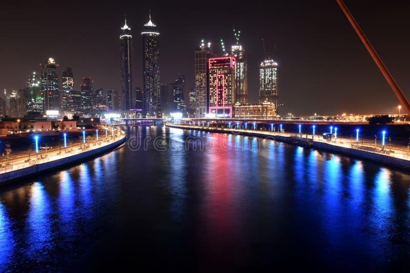 Dubai Skyline at night from new Dubai Canal, U.A.E.  royalty free stock photography
