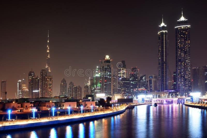 Dubai Skyline at night from new Dubai Canal, U.A.E.  stock images