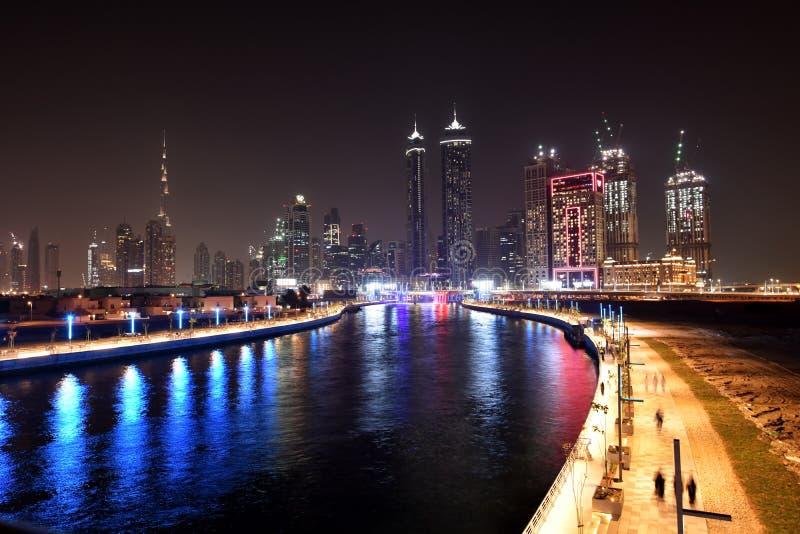 Dubai Skyline at night from new Dubai Canal, U.A.E.  royalty free stock images