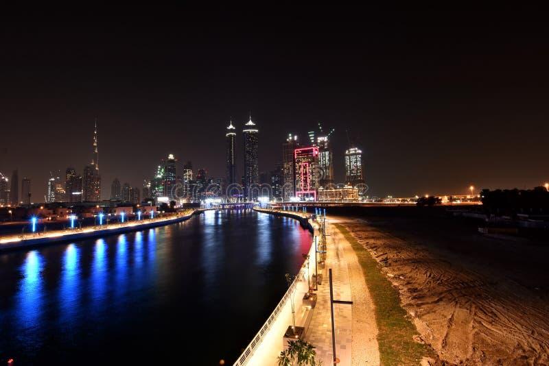 Dubai Skyline at night from new Dubai Canal, U.A.E.  stock photography