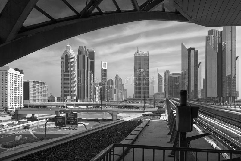 Dubai - The skyscrapers of downtown and the rails of metro stock image