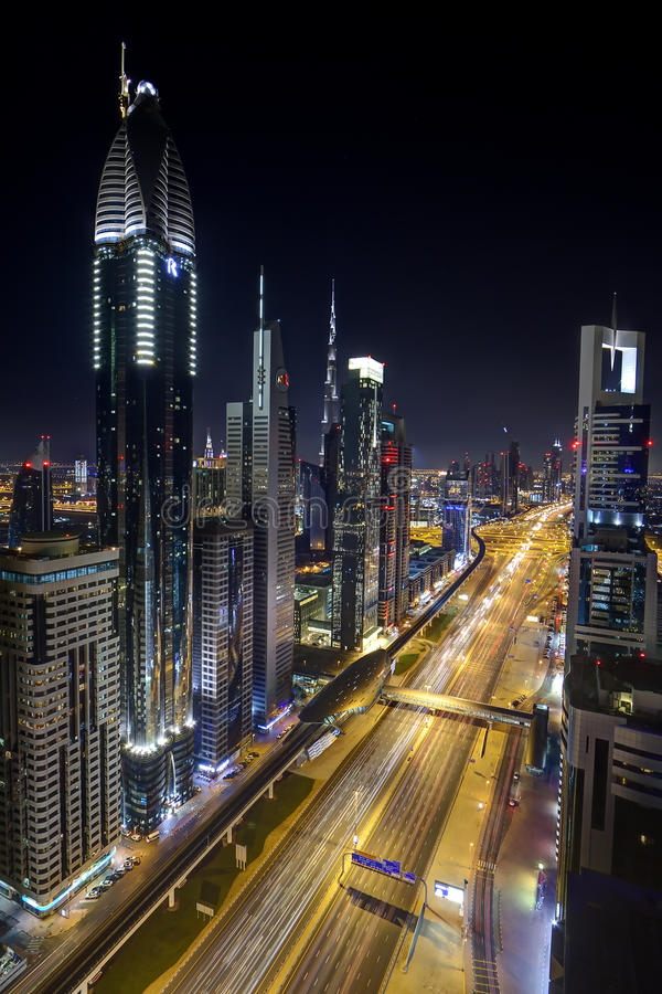 Dubai skyscrapers. Dubai's futuristic skyscrapers lit up at night on Sheikh Zayed Road stock photography