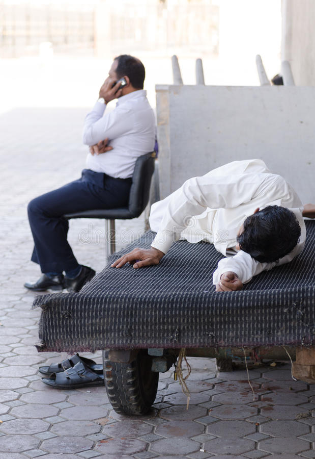 Dubai souk workers taking a break time sleep in the daytime, uae. Dubai souk workers taking a break time sleep in the daytime stock photography