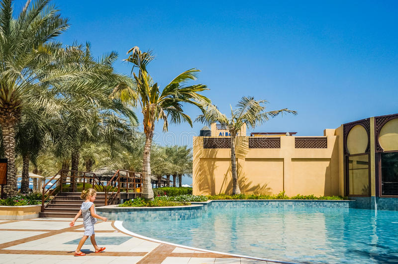 Dubai. In the summer of 2016. Oasis of the Hilton Ras Al Khaima hotel on the Persian Gulf. A little child goes to the pool. royalty free stock photography