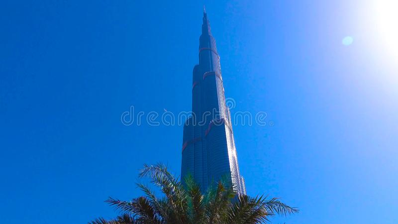 DUBAI, UAE - Burj Khalifa the tallest building in the world. Dubai Downtown cityscape. Dubai evening skyline, busy roads, sunset o royalty free stock photos